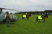 Military helicopter and riders in Hi-Viz