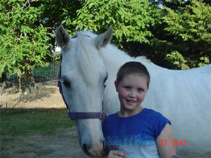 Kelly-Ann and her pony two months after surgey