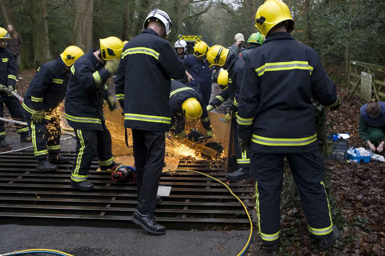 Fire-fighters using cutters on the cattle grid